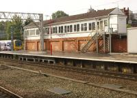 At the south end of Stockport station stands the No.1 Signalbox. Scene in October 2013 with a Northern Class 323 EMU arriving on the left.<br><br>[John McIntyre&nbsp;03/10/2013]