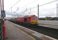 DB Schenker class 60 No.60020 arrives at Penrith on 4 January with an engineers train from Crewe Basford Hall.<br><br>[Ken Browne&nbsp;04/01/2014]