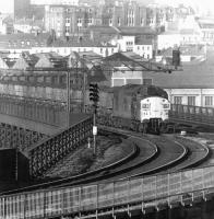 A class 37 with a coal train crossing the River Tyne from Newcastle to Gateshead via the King Edward Bridge in October 1975.<br><br>[John Furnevel&nbsp;20/10/1975]