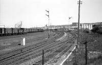 The signals are <I>off</I> but no trains appear; Craiginches North box is switched out one weekend in May 1975. The view is east from the bridge carrying Wellington Road over the railway. Today there are fewer sidings but the Blue Circle cement building still stands.<br><br>[John McIntyre&nbsp;25/05/1975]