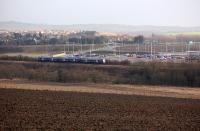 Looking south over the Fife Circle with a passing 170 on 28 January 2014. In the background is the new Halbeath Park and Ride and Crossgates village.  A rail halt is mooted.<br><br>[Bill Roberton&nbsp;28/01/2014]