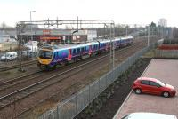 The 11.09 Glasgow Central - Manchester Airport approaching Motherwell on 30 January 2014 after clearing Logans Road level crossing. The train will run non-stop through Motherwell station, its first call being Lockerbie.<br><br>[John Furnevel&nbsp;30/01/2014]