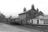 Park Royal railbus SC79974 stands at the buffer stops at Dalmellington station on 5 September 1961 with a service for Ayr.<br><br>[David Stewart&nbsp;05/09/1961]