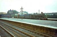 7906 <I>Fron Hall</I> takes a westbound parcels through Basingstoke in August 1964.<br><br>[John Robin 24/08/1964]