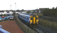 Scotrail DMU 156512 on 2A05 Kilmarnock to Girvan passing the abandoned branch platform at Barassie on 23 January 2014. Housing now covers much of the land once occupied by the former Barassie railway wagon works.<br><br>[Ken Browne&nbsp;23/01/2014]