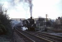 An East Kilbride train calls at Giffnock in April 1966. Locomotive is Corkerhill Standard class 4 tank 80046, complete with Caledonian semaphore route indicator.<br><br>[G W Robin&nbsp;/04/1966]