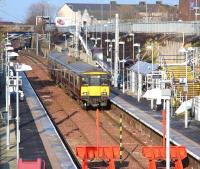 The 11.01 ex-Dalmuir arrives at Larkhall terminus on 30 January 2014 formed by unit 318260. <br><br>[John Furnevel&nbsp;30/01/2014]