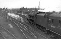 A <I>Royal Scot</I> drifts into Beattock station with a down Anglo - Scottish express in the early 1960s. The train will take on banking assistance here before tackling the climb north. <br><br>[David Stewart&nbsp;//]