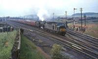 An EE Type 4 pilots Kingmoor Black 5 no 45138 past Strawfrank Junction (now Carstairs South) with a lengthy Liverpool/Manchester train in the summer of 1964.  <br><br>[John Robin&nbsp;24/07/1964]