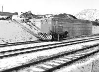 View from a train passing Roughcastle coal loading point, west of Falkirk High, on a cold and snowy 1 March 1986. The loco is F C Hibberd 'Planet' 4wDM 3716 of 1955, which is now preserved on the Tanfield Railway.<br><br>[Bill Roberton&nbsp;01/03/1986]
