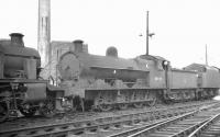 Bletchley based G2 0-8-0 no 48898 stands in the sidings alongside Willesden shed in the summer of 1961.<br><br>[K A Gray&nbsp;21/08/1961]