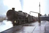 Holbeck Jubilee 45660 <I>Rooke</I> calls at Dumfries on a wet 24 July 1965 with a down relief to the <I>Thames Clyde Express</I>.<br><br>[John Robin&nbsp;24/07/1965]