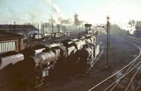 Looking south over Upperby shed in late November 1964. Locomotives in the foreground include 45613, 44461, 46225 and 46237. In the middle distance are two Britannias, with 46238 and 46250 standing to their right.<br><br>[John Robin&nbsp;24/11/1964]