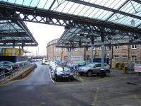 View from the Neville Street entrance of the car park occupying the former goods depot alongside Newcastle Central station, looking along the former bay platforms towards the King Edward Bridge and Forth Banks with a ramp replacing the stop blocks to reach track level.    <br><br>[David Pesterfield&nbsp;04/02/2014]