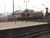 A group of staff undergoing a training exercise that appeared to revolve around Thunderbird 67024 stabled alongside Newcastle Central station during the late morning on 4 February.<br><br>[David Pesterfield&nbsp;04/02/2014]