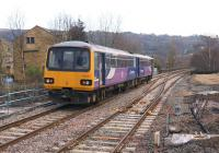The new trailing crossover at the east end of Todmorden station associated with the reinstated north - south curve, seen here on 10 February 2014 as Northern Pacer 144009 departs with a service from Manchester to Leeds.<br><br>[John McIntyre&nbsp;10/02/2014]