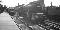 An EE Type 4 prepares to take out the 9.20am Crewe - Aberdeeen from Carlisle on 4 August 1962. Standing alongside is Stanier Pacific 46208 <I>Princess Helena Victoria</I>, which had brought in the train from the south [see image 32298]. Ivatt class 4 no 43027 is on the right of the picture. <br><br>[K A Gray&nbsp;04/08/1962]
