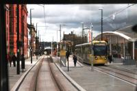 One of three brand new town centre tram stops, this is Oldham Central, opened in January 2014. Tram 3050 is leaving for Manchester on 13 February, seen from a Rochdale bound service.<br><br>[Mark Bartlett&nbsp;13/02/2014]