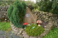 The memorial at Tebay to four track workers, Colin Buckley, Darren Burgess, Gary Tindall and Chris Waters who were killed by a runaway PW trolley on 15 February 2004 while maintaining the railway. The WCML is on the other side of the wall to the left.<br><br>[John McIntyre&nbsp;13/02/2014]