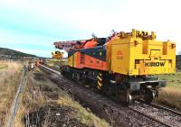 The Colas Crane doing a test run up to the Dulnain Bridge abutment on 14 February, before lifting the first girder.<br><br>[John Gray&nbsp;14/02/2014]