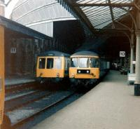 A class 108 dmu standing alongside a class 124 trans-Pennine unit in the old platforms 10 and 11 at York in July 1979. These platforms are currently (2014) numbered 6 and 7 [see image 34776].<br><br>[Colin Alexander&nbsp;15/07/1979]
