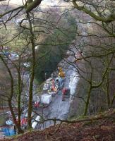 Looking down to the trackbed from above the southern portal of Holme Tunnel on 10 February 2014 as a delivery of cement is being trans-shipped from rail to road before being taken into the tunnel. [See image 46312]<br><br>[John McIntyre&nbsp;10/02/2014]