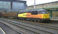 Colas Railfreight 56087 passing through Carlisle station on 5 February 2014 with the Kingmoor - Chirk log train.<br><br>[Ken Browne&nbsp;05/02/2014]