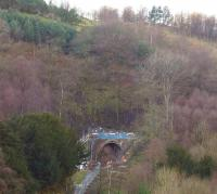 The southern portal of Holme tunnel, seen through the trees on 10 February 2014. It was this hillside that had moved, causing the tunnel walls to distort and leading to the major engineering works currently underway to reline the tunnel. [See image 46314]<br><br>[John McIntyre&nbsp;10/02/2014]
