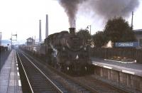 One of Grangemouth's Standard class 4 2-6-0s no 76113 runs south through Cumbernauld station on 3 August 1965 at the head of a mixed freight.  <br><br>[G W Robin&nbsp;03/08/1965]