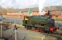 Another quality restoration from the Ribble Steam workshop. Bagnall 2680/1942 made its preservation debut at the 2014 spring gala. The loco was originally <I>Birchenwood No. 4</I> but has been restored from <I>Barry condition</I> as one of the former Preston Dock Bagnalls, <I>Courageous</I>. The 0-6-0ST was one of four RSR locos in steam that day. A crew member goes to attend to the lifting safety valves as it rests at Strand Rd in between gala turns on 16 February 2014.<br><br>[Mark Bartlett&nbsp;16/02/2014]