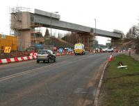The new Borders Railway bridge at Hardengreen complete with deck, seen from the south on Monday morning 17 February, with the road reopened and traffic back to normal on the A7 after the weekend closure. <br><br>[John Furnevel&nbsp;17/02/2014]