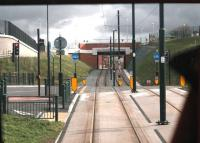 This steep switchback section of tram track is a reminder of why the L&YR did not go into the centre of Oldham but instead went by tunnel from Werneth to Central and on to Oldham Mumps, all skirting the edge of town. The new Metrolink line employs some substantial engineering to reach the town centre and this is a driver's view of the climb from Westwood to Oldham King St.  <br><br>[Mark Bartlett&nbsp;13/02/2014]