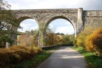 The castellated north end of the 1863 Edinkillie Railway Viaduct over the River Divie in Morayshire, complemented by the surrounding autumn colours in October 2005. The grade B listed structure, generally referred to as The Divie Viaduct,  is located between Dava and Dunphail and now forms part of The Dava Way. [See image 5793]<br><br>[John Furnevel&nbsp;31/10/2005]