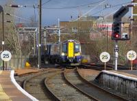 The 10.30 ex Glasgow Central snakes across the layout at the north end of Ayr station from the down line into Platform 1.<br> <br><br>[Colin Miller&nbsp;21/02/2014]