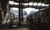 The BR (Scottish Region) <I>Grand Rail Tour no 5</I> stands in the shadows at Manchester Victoria on 1 June 1968 behind Britannia Pacific no 70013 <I>Oliver Cromwell</I>.<br><br>[John Robin&nbsp;01/06/1968]