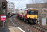 318259 enters Partick with an eastbound service on 22 February.  The platforms of the earlier station survive in the background beyond the Dumbarton Road bridge. <br><br>[Bill Roberton&nbsp;22/02/2014]