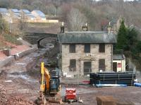 A quiet Saturday afternoon at Gorebridge on 22 February 2014. The old station building looks on as the surroundings undergo still further change. Note the (extensive) new housing development taking place beyond the B6372 Lady Brae road bridge in the left background.<br><br>[John Furnevel&nbsp;22/02/2014]