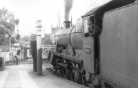 A pleasant August afternoon at Gobowen station in 1960, with Worcester based Modified Hall 4-6-0 no 6984 <I>Owsden Hall</I> at the platform awaiting departure with a northbound train towards Wrexham.  <br><br>[David Stewart&nbsp;/08/1960]