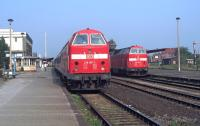 Just before nine o'clock on the cloudless morning of 18th August 2002, 219 197 is about to leave Halberstadt for Thale with the 07:44 from Magdeburg while on the right 219 165 will set off in the opposite direction on the 08:17 from Thale. These workings have long since gone over to dmus operated by Connex Sachsen-Anhalt.<br><br>[Bill Jamieson&nbsp;18/08/2002]