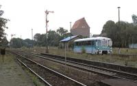 Until late 2002 Heudeber-Danstedt was a junction on the Halberstadt - Wernigerode - Goslar cross-country line, with a branch striking off north-westwards to Osterwieck. Not long before closure in late 2002, single-unit former DR <i>piglet taxi</i> No. 772 345 approaches the weed infested branch platform at Heudeber-Danstedt with a late afternoon working from Osterwieck-West. The branch can be seen diverging to the right of the signal-box in the left background. <br><br>[Bill Jamieson&nbsp;17/08/2002]