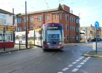 <I>Flexity</I> tram 013 swings round the corner into the Fleetwood Ferry stop on a service from Starr Gate on 27 February. The Blackpool & Fleetwood Tramway is double track along its entire length apart from this loop at the northern terminus.<br><br>[Mark Bartlett&nbsp;27/02/2014]