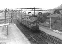 An eastbound train for Bridgeton arrives at Dalmuir in 1960 (named Dalmuir Park at that time). Photographed shortly after the commencement of electric services on the line.<br><br>[David Stewart&nbsp;//1960]