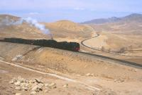 The start of the heavy grades and spiralling lines at Reshui, Inner Monglia, in April 2000. The arrangement enables heavy freights to climb over the Jing Peng mountain range. [See image 20082]<br><br>[Peter Todd&nbsp;15/04/2000]
