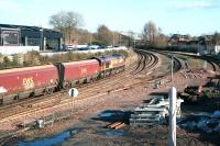 66053 takes an up coal train south through Dumfries on 3 March 2014 The train has just passed below the A780 Annan Road bridge.   <br><br>[John Furnevel&nbsp;03/03/2014]