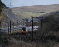 A northbound service climbing fast on the reverse curves just north of Harthope Viaduct.<br><br>[Ewan Crawford&nbsp;03/03/2014]