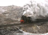 The Chengde branch line north of Beijing feeds coal to a local steel mill. The train is in the process of climbing a five mile 1:75 gradient. [See image 32581]<br><br>[Peter Todd 09/04/2000]