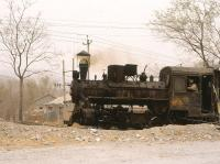 The narrow gauge railway at Daihuchang, China, in April 2000. A C Class 0-8-0 tender engine in action hauling limestone to a local steel mill. <br><br>[Peter Todd&nbsp;08/04/2000]