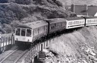 A DMU for Pwllheli comes off Barmouth Viaduct in July 1981.<br><br>[Colin Miller /07/1981]