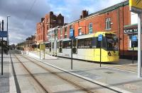 A four-car Metrolink tram leaves the new Oldham Central stop heading for Rochdale on 13 February. Road vehicles are excluded from this particular stretch of the <I>street running</I> section of the new line, which had only opened during the previous month. <br><br>[Mark Bartlett&nbsp;13/02/2014]