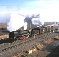 QJ3251 at Da-an Bei, Inner Mongolia, a junction town where class QJ 2-10-2  locomotives appeared regularly on passing freights. Photographed on 17 April 2000.  <br><br>[Peter Todd&nbsp;17/04/2000]